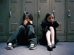 kids sitting by the lockers