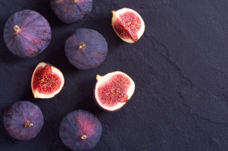 Ripe sweet figs . Healthy mediterranean fig fruit . Top view , space for text