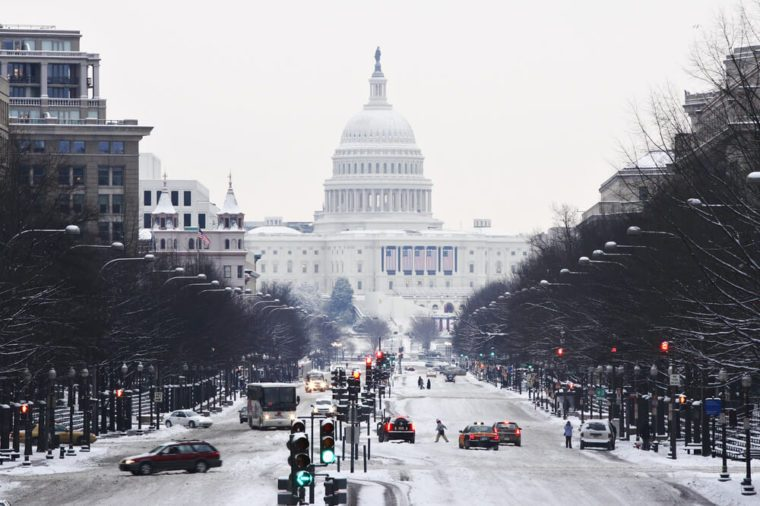 View down Pennsylvania Avenue to the United States Capitol during a winter snow storm.