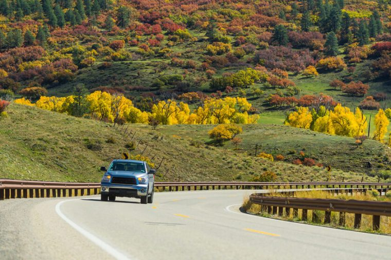 North american endless asphalt mountain road with a pickup in beautiful sunny autumn weather somewhere in the USA