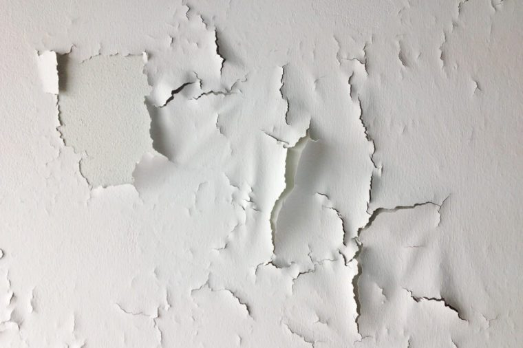 Cracked wall, Paint white peeling off an old interior wall.