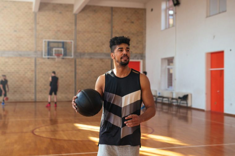 Handsome african american basketball player preparing for free throw.