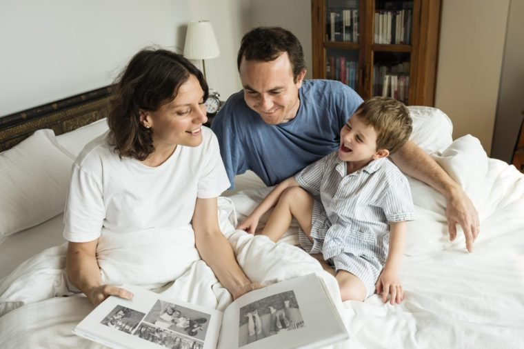 Family looking and sharing memories by the photo album