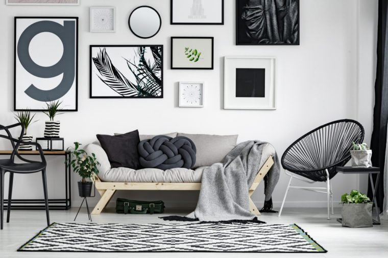 help me accessorize my living room artwork decor how to make your home look expensive reader s digest wooden sofa with dark pillows in scandi style