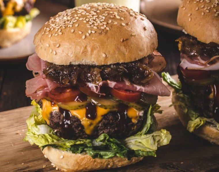 Homemade beef burger, caramelized onion, bacon and beer, food photography