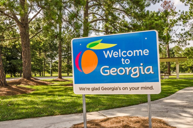 State sign for Georgia welcomes visitors in a shaded rest area