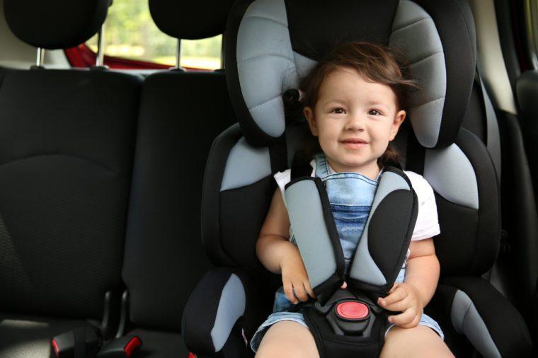 Boy sitting in a car in safety chair