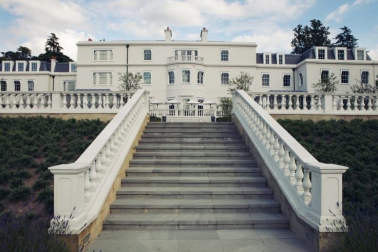 white mansion with grand staircase