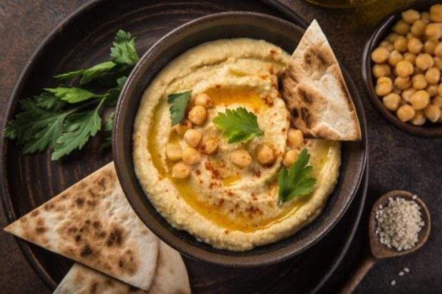 chickpeas hummus with olive oil and smoked paprika, selective focus