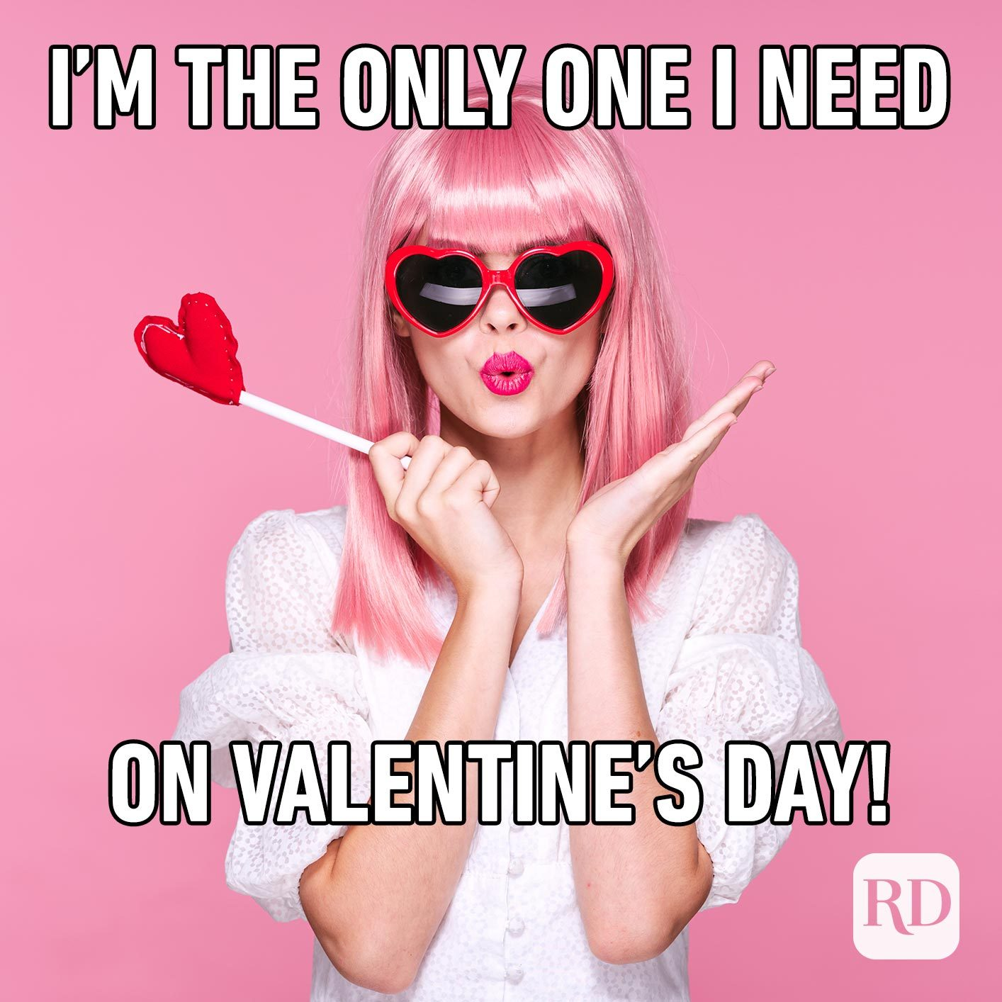 Woman in pink wig with heart-shaped sunglasses. Meme text: I'm the only one I need on Valentine's day.