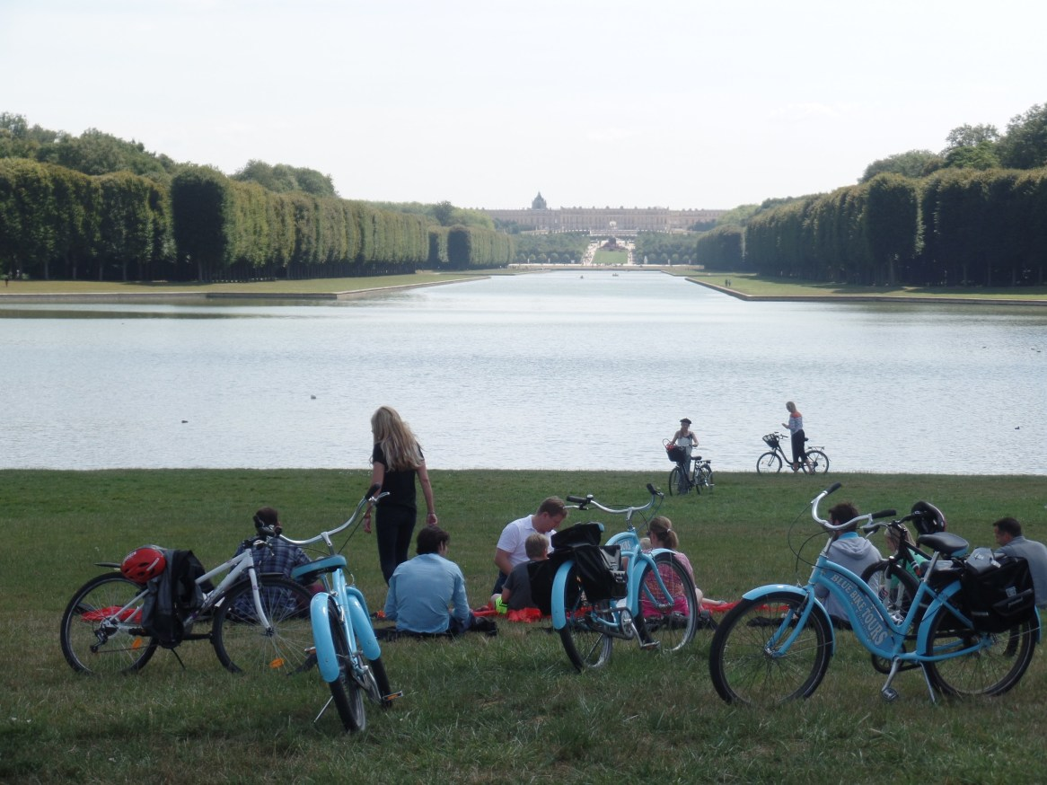 Our baguette-and-cheese picnic next to the grand canal, with Versailles in the background. Could anything be more French?
