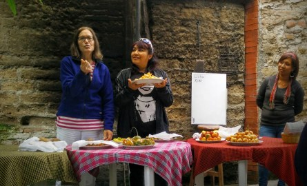 "Claudia, from British Columbia, during Jennifer (a fellow student), during the ""exposición de frutas"""