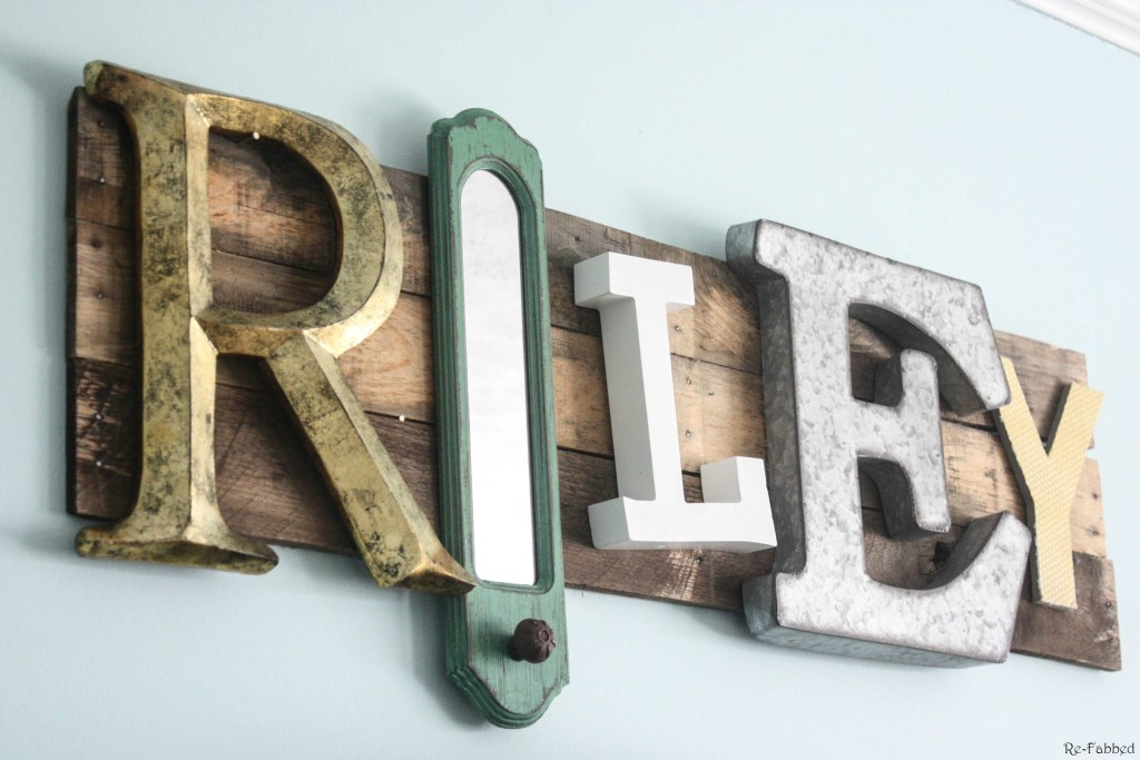 Pallet Name Sign made from random pieces of decor and letters