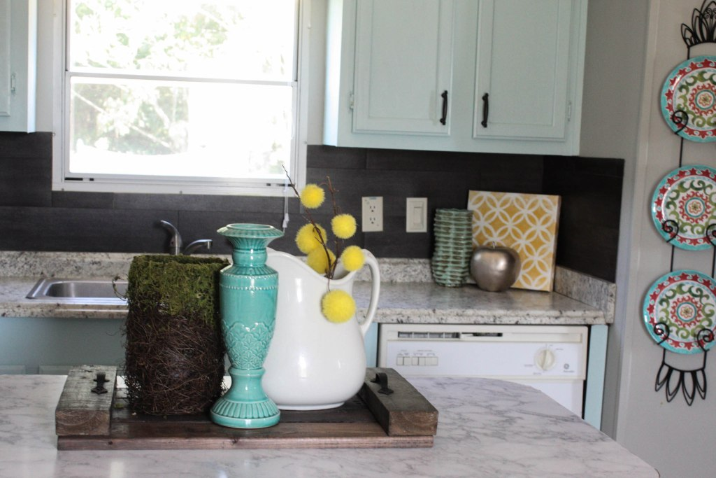 Great idea for using vinyl flooring as a kitchen backsplash!