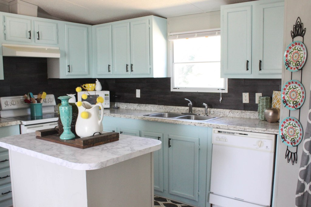 Installing a vinyl flooring kitchen backsplash for $40!