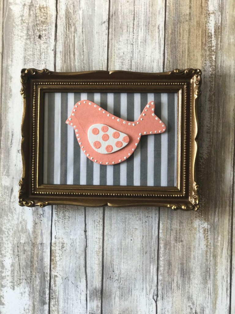Thrifted Fabric Frame with bird attachment that can be changed with the seasons!