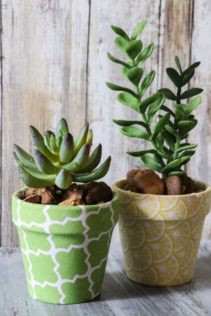 Super cute DIY Fabric Covered Flower Pots with Dollar Tree materials and cute little succulents! This is ADORABLE!