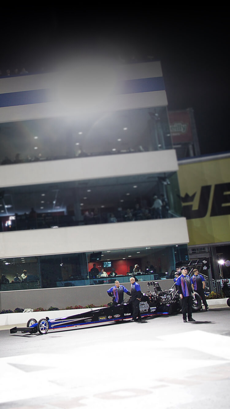 Pat Dakin, 2019 International Drag Racing Hall of Fame inductee, prepares for a pass under the lights at ZMAX Dragway..