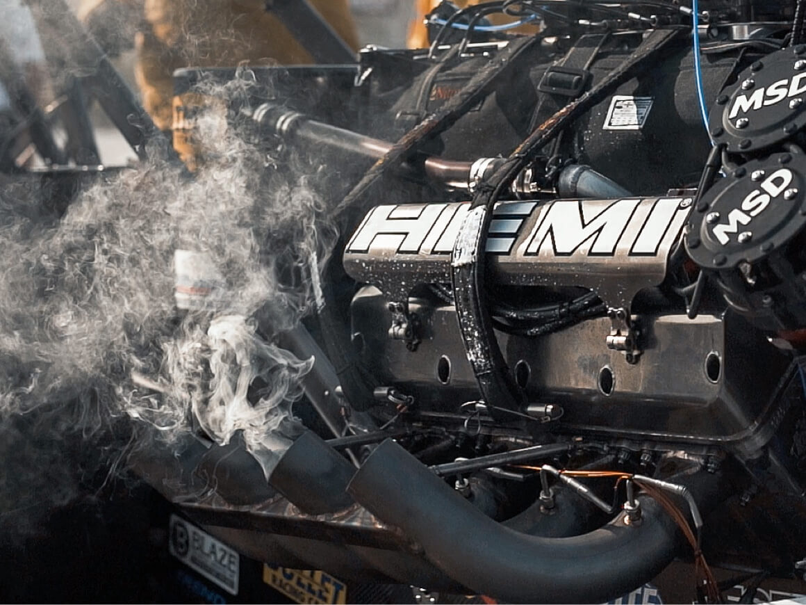 Smoke emanates from the headers of Leah Pruett's Top Fuel Dragster after making a run at the 2020 NHRA Winternationals.