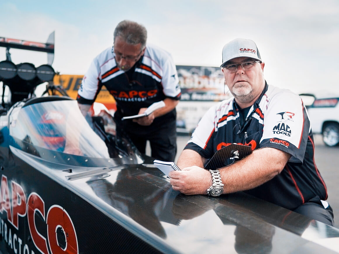 Billy Torrence co-crew chief, Jason McCulloch, makes last minute adjustments on the Capco Contractors Top Fuel Dragster prior to the final round of the 2019 NHRA U.S. Nationals.