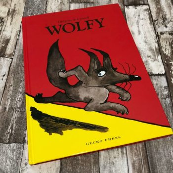Our review of Wolfy by Gregoire Solotareff - book on wooden background