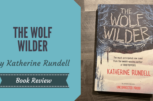 The Wolf Wilder by Katherine Rundell on a wooden background with a blog title graphic overlay