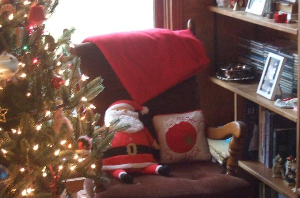 empty chair and a christmas tree