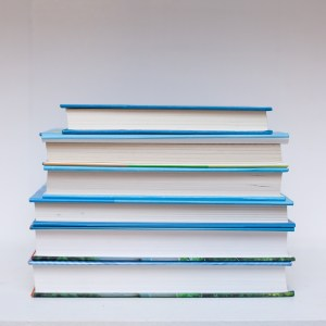 Read Remark - blue hardback book stack