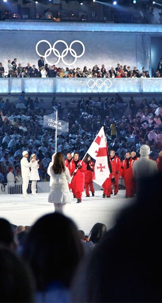 The Orthodox Church is very strong in Georgia as shown on the nation's cross-covered flag. Here, athletes carried the flag into the 2010 Winter Olympics. Photo courtesy of Wikimedia Commons.