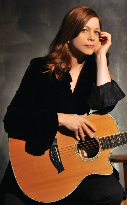 Carrie_Everything_is_Everywhere_black_jacket_guitar