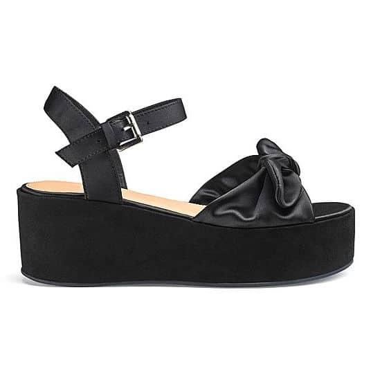 black bow platform sandal pumps