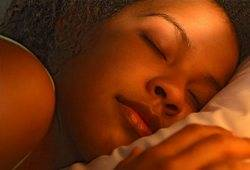 Woman sleeping peacefully - regular sleep is among good memory improvement tips