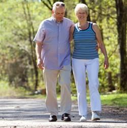 older people walking in a park