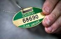The cabbie badge - that's what The Knowledge was leading up to!