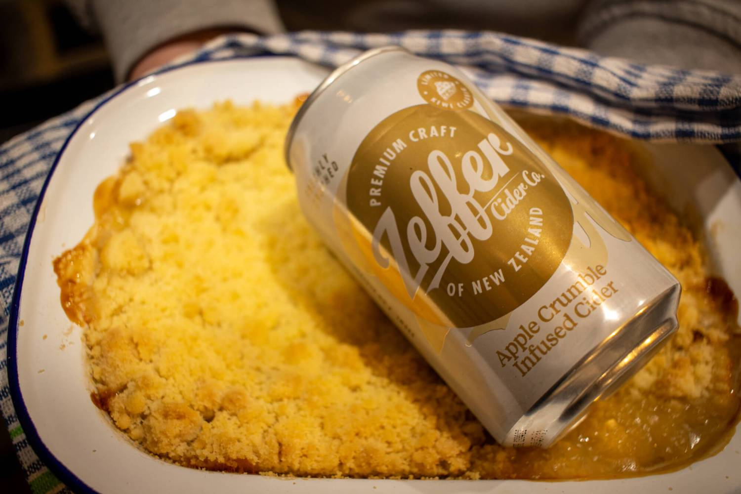 a can of Zeffer Apple Crumble Infused Cider in a apple crumble tray