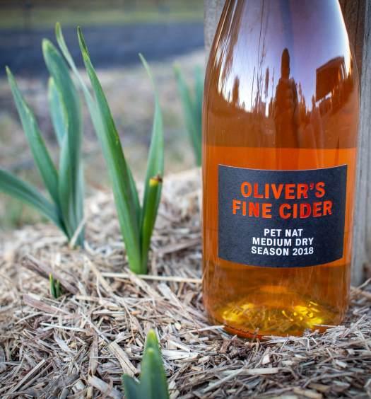 Tom Olivers Pet Nat Cider sitting on a flower bed