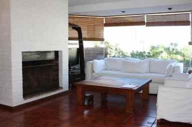 4478-Fireplace-of-Brick-Home-in-La-Barra