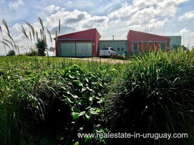 House front of Modern Sustainable Bio Chacra in Pueblo Eden New Built