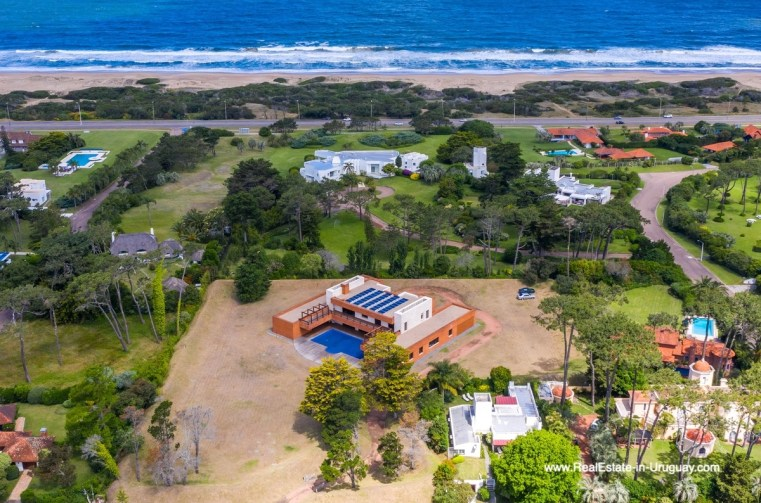 View from Air with ocean of High-Tech State of the Art and Modern Estate on the Brava Beach in Punta del Este with a large Garden