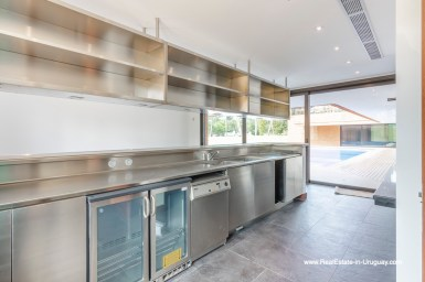 BBQ Kitchen of High-Tech State of the Art and Modern Estate on the Brava Beach in Punta del Este with a large Garden