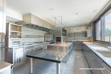 High-end Kitchen of High-Tech State of the Art and Modern Estate on the Brava Beach in Punta del Este with a large Garden