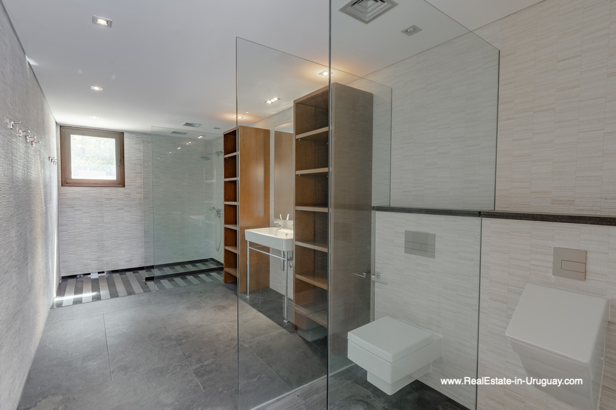 Pool Bathroom of High-Tech State of the Art and Modern Estate on the Brava Beach in Punta del Este with a large Garden