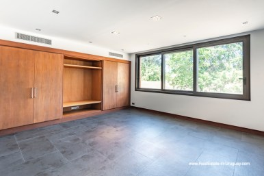 TV room of High-Tech State of the Art and Modern Estate on the Brava Beach in Punta del Este with a large Garden
