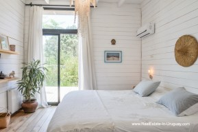 Master Bedroom of Cute House in a Quiet Area by La Barra