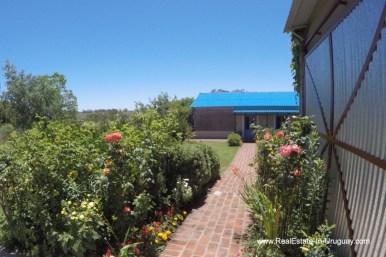 Walkway of Charming-Farm-between-Ruta-104-and-Santa-Monica-Entrance