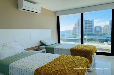 Guest Bedroom of Apartment with Sea and Sunset Views