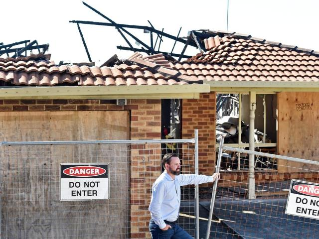 Burnt out Berkeley Vale crime scene house sold for 'shock' auction result
