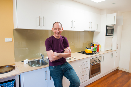 Man standing in kitchen of  Flemington VIC home