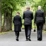 family walking in a cemetery