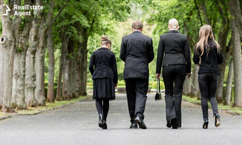 family walking in a cemetery